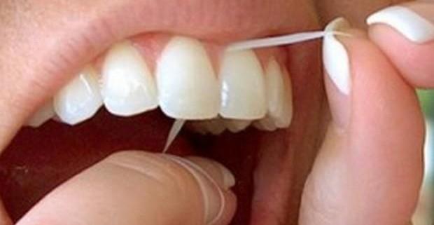 Обычная зубная нить – вред или польза?